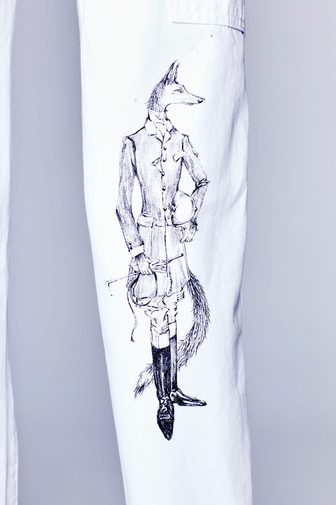 Detail view of Natasha Portait Pant by Natasha Blodgett featuring a fox in Hunt Attire